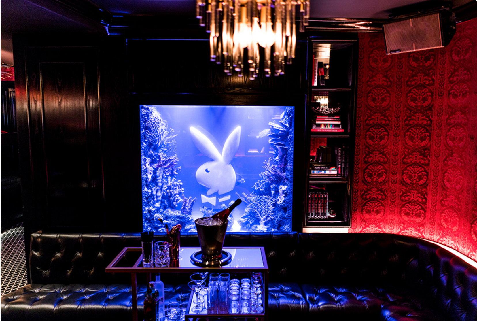 Playboy Club Interior shows lights, booth, bunny image